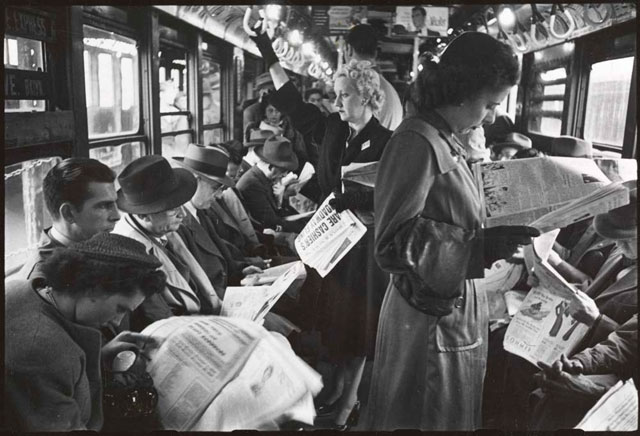 Image result for people reading papers on the train