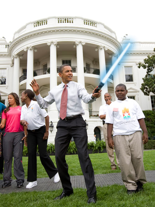 Above: Obama yielding a light saber on the White House front yard because he can.